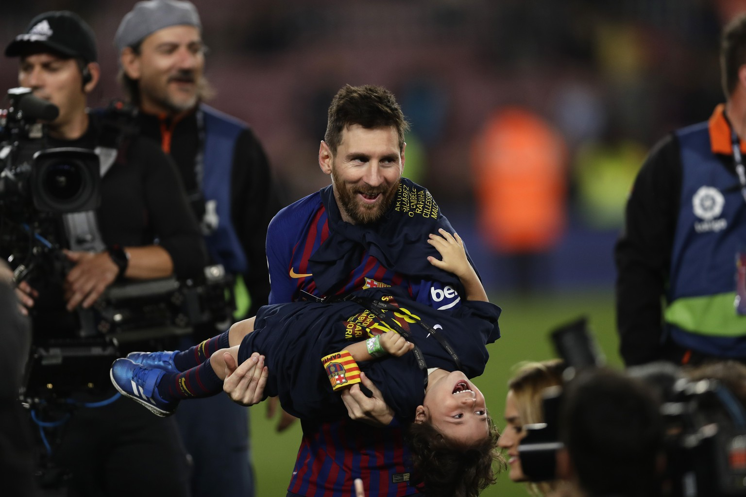 Barcelona forward Lionel Messi celebrates with his son after winning the Spanish League title, at the end of the Spanish La Liga soccer match between FC Barcelona and Levante at the Camp Nou stadium in Barcelona, Spain, Saturday, April 27, 2019. Barcelona clinched the Spanish La Liga title, with three matches to spare, after it defeated Levante 1-0. (AP Photo/Manu Fernandez)