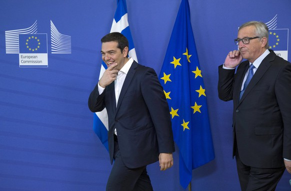 """Greek Prime Minister Alexis Tsipras (L) is welcomed by European Commission President Jean Claude Juncker (R) for a meeting ahead of a Eurozone emergency summit on Greece in Brussels, Belgium June 22, 2015. The European Union welcomed new proposals from Greek Prime Minister Alexis Tsipras as a """"good basis for progress"""" at talks on Monday where creditors want 11th-hour concessions to haul Athens back from the brink of bankruptcy.  REUTERS/Yves Herman"""