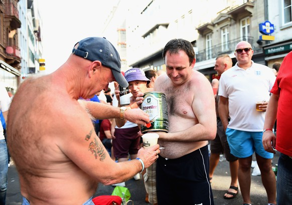 BASEL, SWITZERLAND - SEPTEMBER 08:  England fans enjoy a beer in the sunshine ahead of the UEFA EURO 2016 Qualifier between Switzerland and England on September 8, 2014 in Basel, Switzerland.  (Photo by Laurence Griffiths/Getty Images)