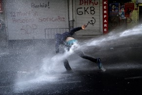 epaselect epa04219831 Turkish riot police use a water cannon to disperse protestors during a protest against the government, in Istanbul, Turkey, 22 May 2014. A group of protestors clashed with Turkish riot police during a protest against the Turkish government that they see responsible for the Soma mine explosion. Prime Minister Recep Tayyip Erdogan's AKP reportedly rejected a motion by the centre-left People's Republican Party (CHP) in April to review safety at the Soma mine. The worst mining disaster in the country's history left at least 301 workers dead.  EPA/ULAS YUNUS TOSUN