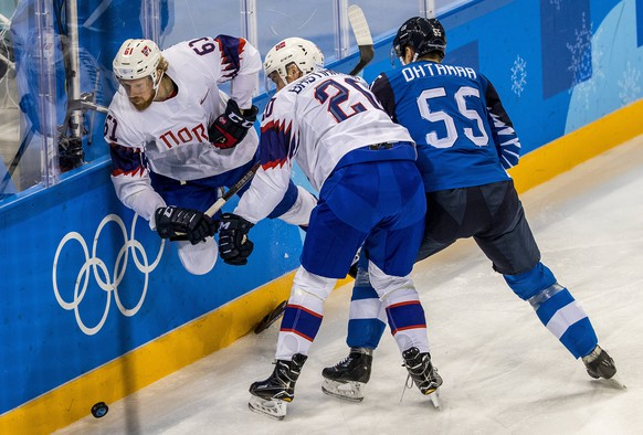 epa06532652 Alexander Reichenberg (L) and Anders Bastiansen (C) of Norway in action against Atte Ohtamaa (R) of Finland during the mens preliminary round match between Finland and Norway at the Gangneung Hockey Centre at the PyeongChang Winter Olympic Games 2018, in Gangneung, South Korea, 16 February 2018. The PyeongChang 2018 Winter Olympic Games, will run from 09 to 25 February 2018.  EPA/SRDJAN SUKI