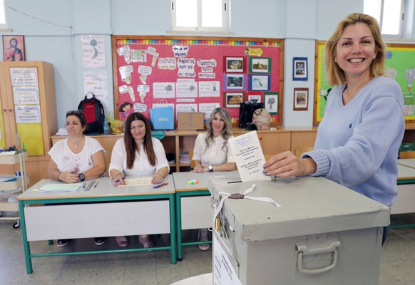 epa07602003 A Greek Cypriot woman casts her vote during the European elections in Nicosia, Cyprus, 26 May 2019. The European Parliament election is held by member countries of the Eu-ropean Union (EU) from 23 to 26 May 2019.  EPA/KATIA CHRISTODOULOU