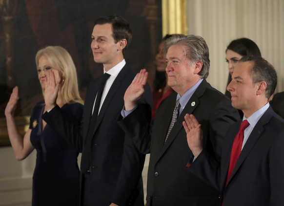 Senior staff at the White House Kellyanne Conway, Jared Kushner, Steve Bannon and Reince Priebus (L-R) are sworn in by Vice President Mike Pence in Washington, DC January 22, 2017.  REUTERS/Carlos Barria