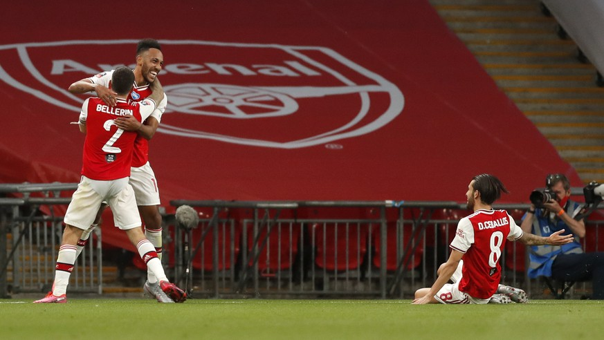 Arsenal's Pierre-Emerick Aubameyang, centre, celebrates with teammates after scoring his team's second goal during the FA Cup semifinal soccer match between Arsenal and Manchester City at Wembley in London, England, Saturday, July 18, 2020. (AP Photo/Matt Childs,Pool)