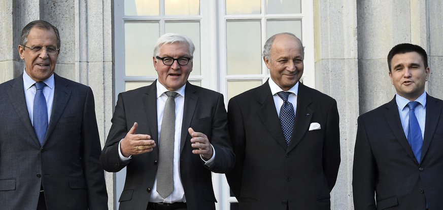 Foreign ministers (L-R) Sergei Lavrov of Russia, Frank-Walter Steinmeier of Germany, Laurent Fabius of France and Pavlo Klimkin of Ukraine pose for a picture ahead of their meeting at the German foreign ministry's Villa Borsig at lake Tegel in Berlin, Germany September 12, 2015. REUTERS/Tobias Schwarz/Pool