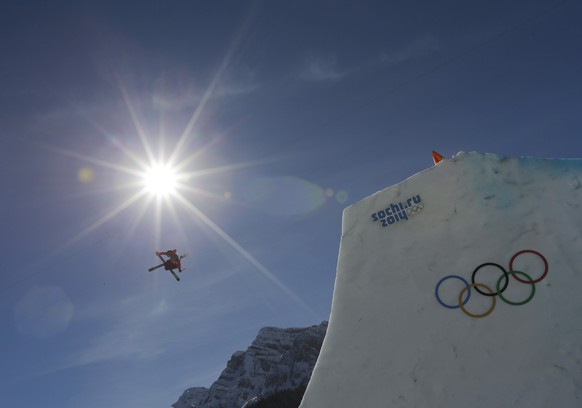 Switzerland's Kai Mahler takes a jump during men's ski slopestyle training at the Rosa Khutor Extreme Park, at the 2014 Winter Olympics, Wednesday, Feb. 12, 2014, in Krasnaya Polyana, Russia. (AP Photo/Andy Wong)