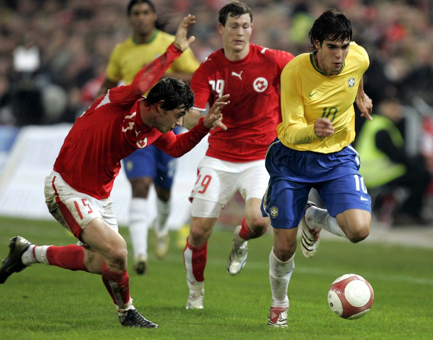 Switzerland's Blerim Dzemaili and Stephan Lichtsteiner fight for the ball with Brazil's Kaka, from left, during the friendly soccer match between Switzerland and Brazil at the St. Jakob Park stadium in Basel, Switzerland, Wednesday, November 15, 2006. (KEYSTONE/Georgios Kefalas)