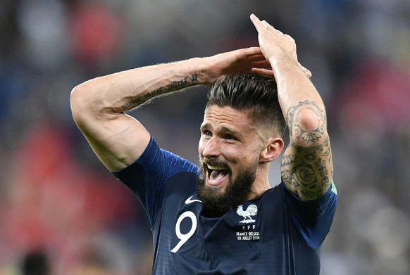 France's Olivier Giroud celebrates after his team advanced to the final after the semifinal match between France and Belgium at the 2018 soccer World Cup in the St. Petersburg Stadium in St. Petersburg, Russia, Tuesday, July 10, 2018. (AP Photo/Martin Meissner)