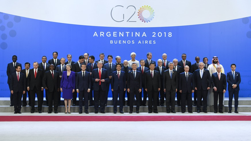 epa07200276 Leaders of the G20 pose for the official family picture at the G20 summit in Buenos Aires, Argentina, 30 November 2018. The Group of Twenty (G20) Summit brings together the heads of State or Government of the 20 largest economies and takes place from 30 November to 01 December 2018.  EPA/LUKAS COCH  AUSTRALIA AND NEW ZEALAND OUT