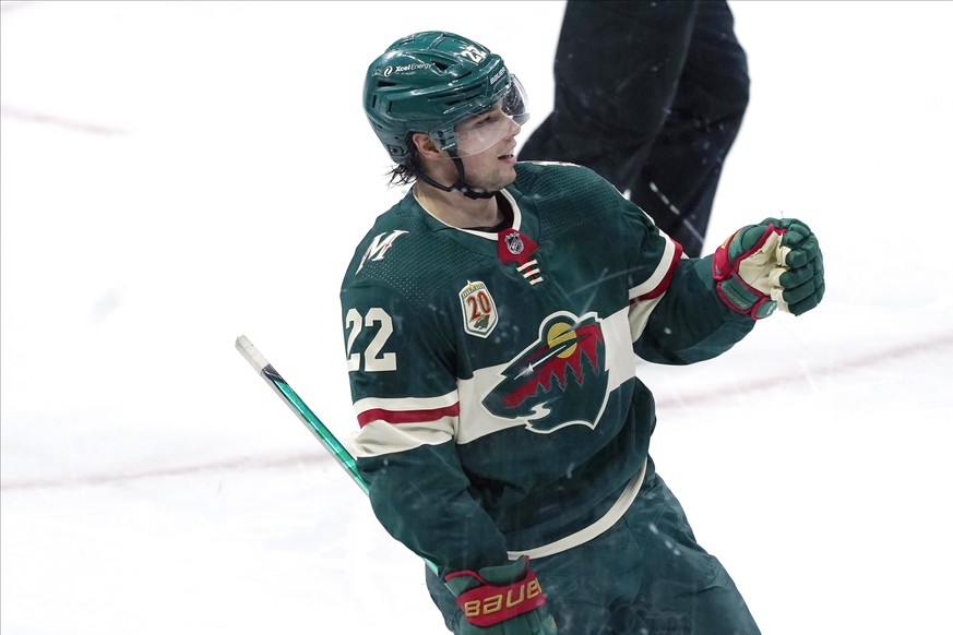 Minnesota Wild's Kevin Fiala (22) celebrates his empty-net goal against the San Jose Sharks in the third period of an NHL hockey game, Friday, Jan. 22, 2021, in St. Paul, Minn. (AP Photo/Jim Mone) Kevin Fiala