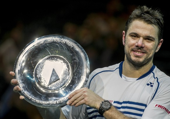 Switzerland's Stan Wawrinka poses with his trophy after he won the final match against Czech Republic's Thomas Berdych during the 42nd ABN AMRO world tennis tournament at Ahoy Arena in Rotterdam, Netherlands, Sunday, Feb. 15, 2015. (AP Photo/Patrick Post)