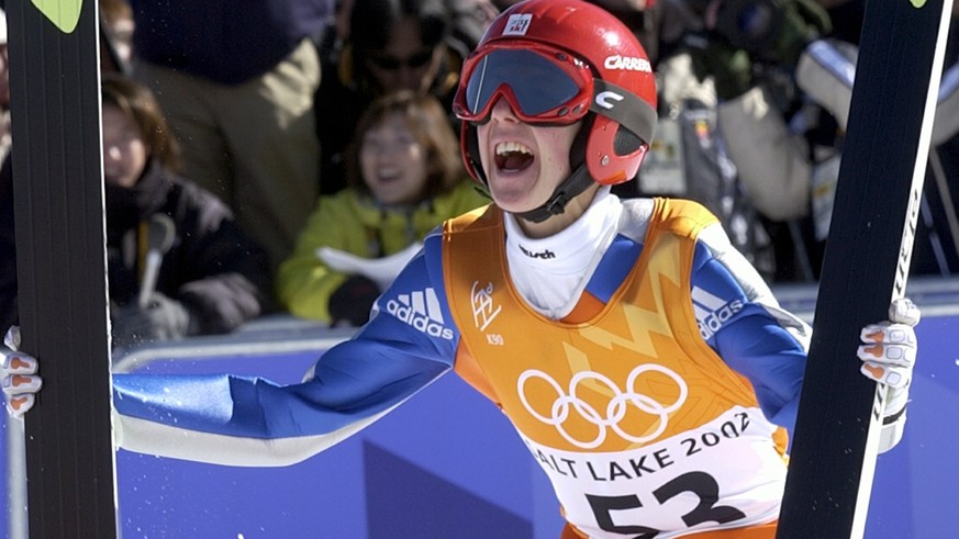 Simon Ammann of Switzerland celebrates his gold medal winning jump after the K90 Individual ski jump at the 2002 Salt Lake City Winter Olympics in Park City, Utah, Sunday, Feb. 10, 2002.  (KEYSTONE/Karl Mathis)