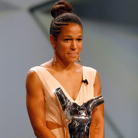 CORRECTS NAME OF PLAYER - Francfort's Celia Sasic, holds her trophy after winning the woman's best player of the year trophy during the UEFA Champions League draw at the Grimaldi Forum, in Monaco, Thursday, Aug. 27, 2015. (AP Photo/Claude Paris)