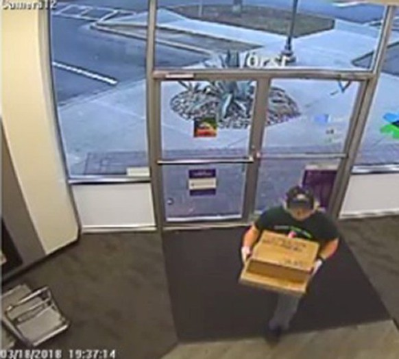 A surveillance image shows the serial bombing suspect entering a FedEx office store in Austin, Texas, U.S., which was given to law enforcement and obtained by TV station, WOAI/KABB, March 21, 2018.     Courtesy of WOAI/KABB/Handout via Reuters ATTENTION EDITORS - THIS IMAGE WAS PROVIDED BY A THIRD PARTY. NO ARCHIVES. NO RESALES. MANDATORY CREDIT. NO ACCESS TEXAS/TEXAS OUT