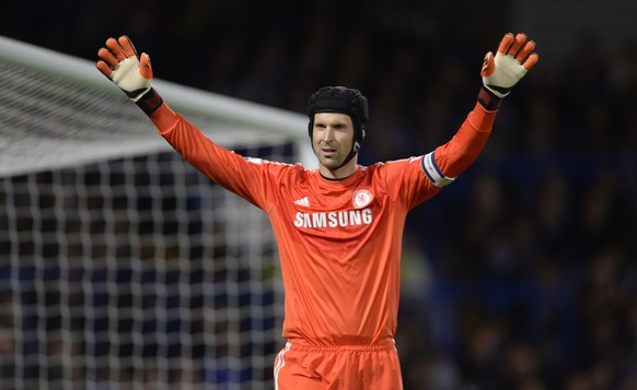 Chelsea's Petr Cech waves his arms during the English League Cup soccer match against Bolton Wanderers at Stamford Bridge in London September 24, 2014. REUTERS/Philip Brown (BRITAIN - Tags: SPORT SOCCER)