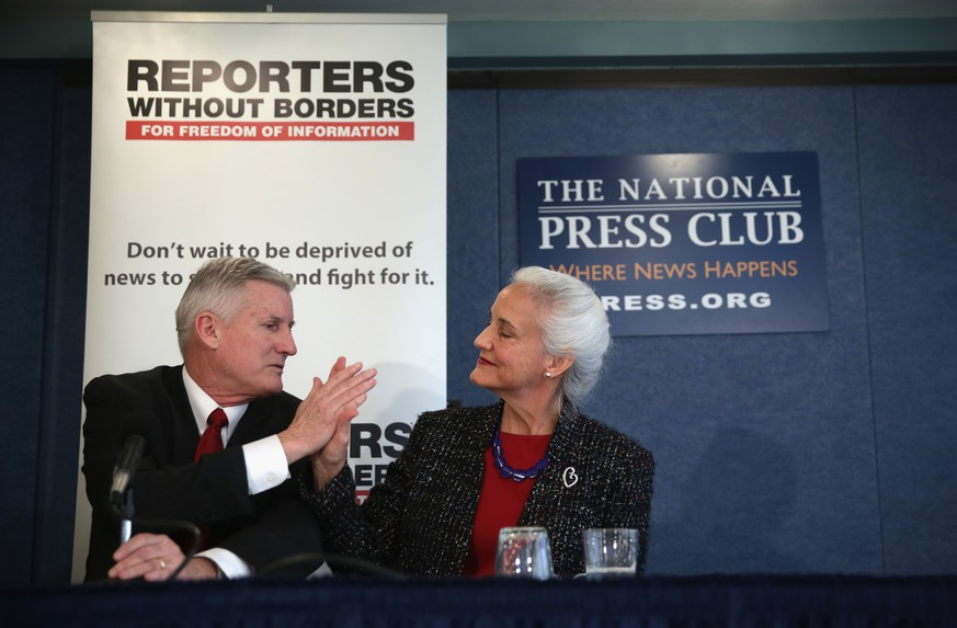 WASHINGTON, DC - FEBRUARY 05:  Deborah Tice (R) high-fives her husband Marc (L) as they discuss their missing son Austin Tice, a journalist who has been missing in Syria since August, 2012, during a news conference at the National Press Club February 5, 2015 in Washington, DC. The parents of Austin Tice held the news conference to discuss his disappearance and announced the launch of the Free Austin Tice campaign.  (Photo by Alex Wong/Getty Images)