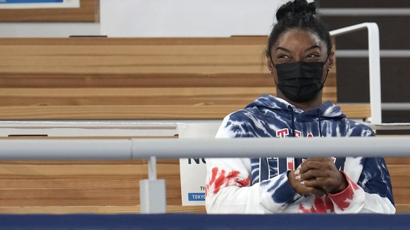 Simone Biles, of the United States, and teammate Mykayla Skinner watch the artistic gymnastics men's all-around final at the 2020 Summer Olympics, Wednesday, July 28, 2021, in Tokyo. (AP Photo/Natacha Pisarenko)