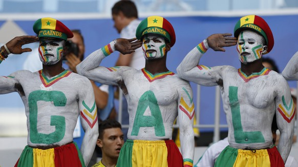 Supporters of Senegal pose prior to the group H match between Senegal and Colombia, at the 2018 soccer World Cup in the Samara Arena in Samara, Russia, Thursday, June 28, 2018. (AP Photo/Efrem Lukatsky)