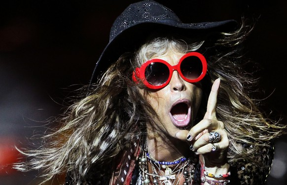 Steven Tyler, lead singer of American rock band Aerosmith performs on Saturday, May 25, 2013 in Singapore during the inaugural Social Star Awards concert.(AP Photo/Wong Maye-E)