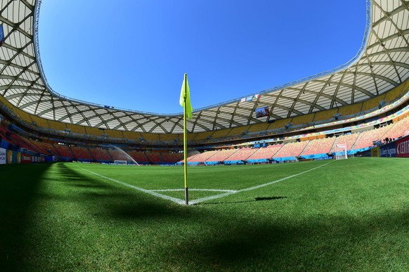 A general view shows the pitch at the Amazonia Arena in Manaus on June 13, 2014, on the eve of the 2014 FIFA World Cup football match between England and Italy.   AFP PHOTO/ GIUSEPPE CACACE