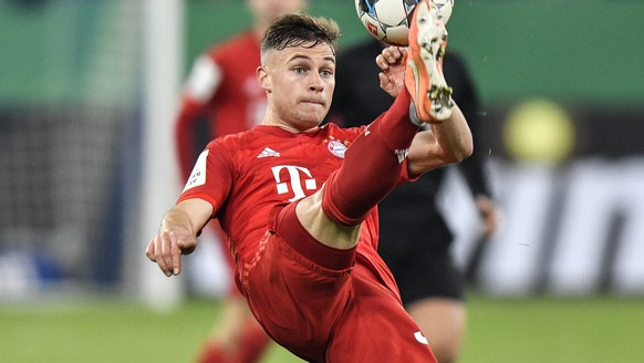 Bayern's Joshua Kimmich plays the ball during the German soccer cup, DFB Pokal, quarter-final match between FC Schalke 04 and Bayern Munich in Gelsenkirchen, Germany, Tuesday, March 3, 2020. (AP Photo/Martin Meissner)