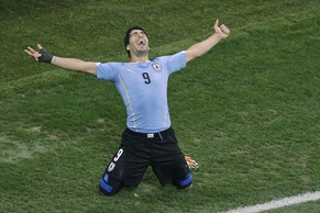 FILE - In this  June 19, 2014 file photo, Uruguay's Luis Suarez celebrates scoring 2-1 during the group D World Cup soccer match between Uruguay and England at the Itaquerao Stadium in Sao Paulo, Brazil. Barcelona reached agreement with Liverpool on the transfer of Luis Suarez on Friday July 11, 2014, giving the troubled striker a chance to rehabilitate his image when his latest biting ban is over. Suarez will travel to Barcelona next week for a medical and to sign a five-year contract. (AP Photo/Michael Sohn, File)