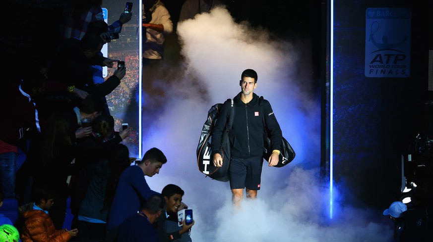 LONDON, ENGLAND - NOVEMBER 15: Novak Djokovic of Serbia enters the court in the singles semi-final match against Kei Nishikori of Japanon day seven of the Barclays ATP World Tour Finals at O2 Arena on November 15, 2014 in London, England.  (Photo by Clive Brunskill/Getty Images)