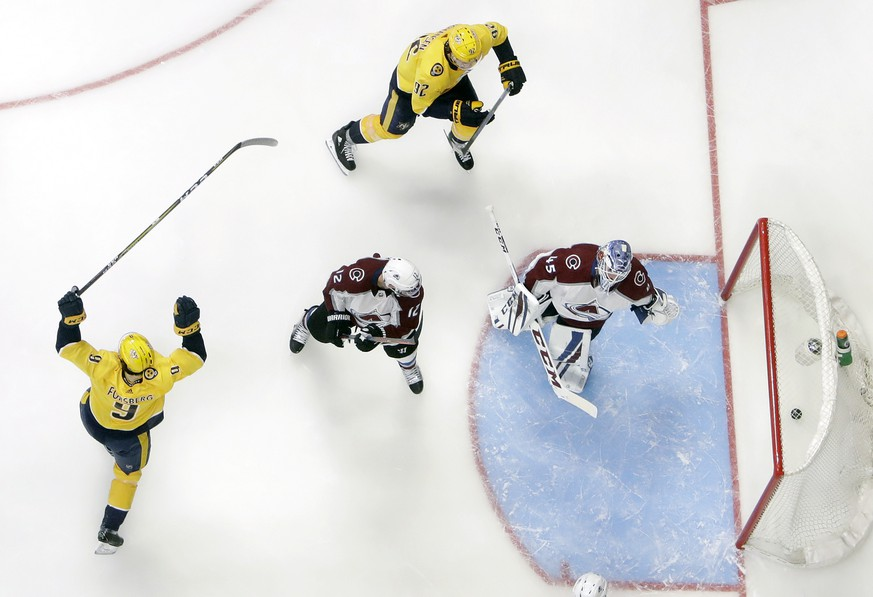 Nashville Predators left wing Filip Forsberg (9), of Sweden, celebrates after scoring a goal against Colorado Avalanche goaltender Jonathan Bernier during the third period in Game 1 of an NHL hockey first-round playoff series Thursday, April 12, 2018, in Nashville, Tenn. (AP Photo/Mark Humphrey)