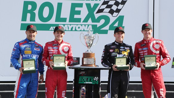 DAYTONA BEACH, FL - JANUARY 25: The #02 Chip Ganassi Racing with Felix Sabates Target/Ford EcoBoost Riley driven by (l-r) Tony Kanaan, Kyle Larson, Jamie McMurray and Scott Dixon receive Rolex watches after winning The Rolex 24 at Daytona at Daytona International Speedway on January 25, 2015 in Daytona Beach, Florida.   Jerry Markland/Getty Images/AFP== FOR NEWSPAPERS, INTERNET, TELCOS & TELEVISION USE ONLY ==