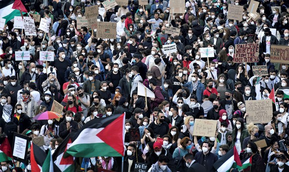 People attend a protest rally in solidarity with Palestinians in Berlin, Germany, Saturday, May 15, 2021. (AP Photo/Michael Sohn)
