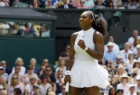 Serena Williams of the U.S celebrates after beating Elena Vesnina of Russia in their women's singles match on day eleven of the Wimbledon Tennis Championships in London, Thursday, July 7, 2016. (AP Photo/Kirsty Wigglesworth)