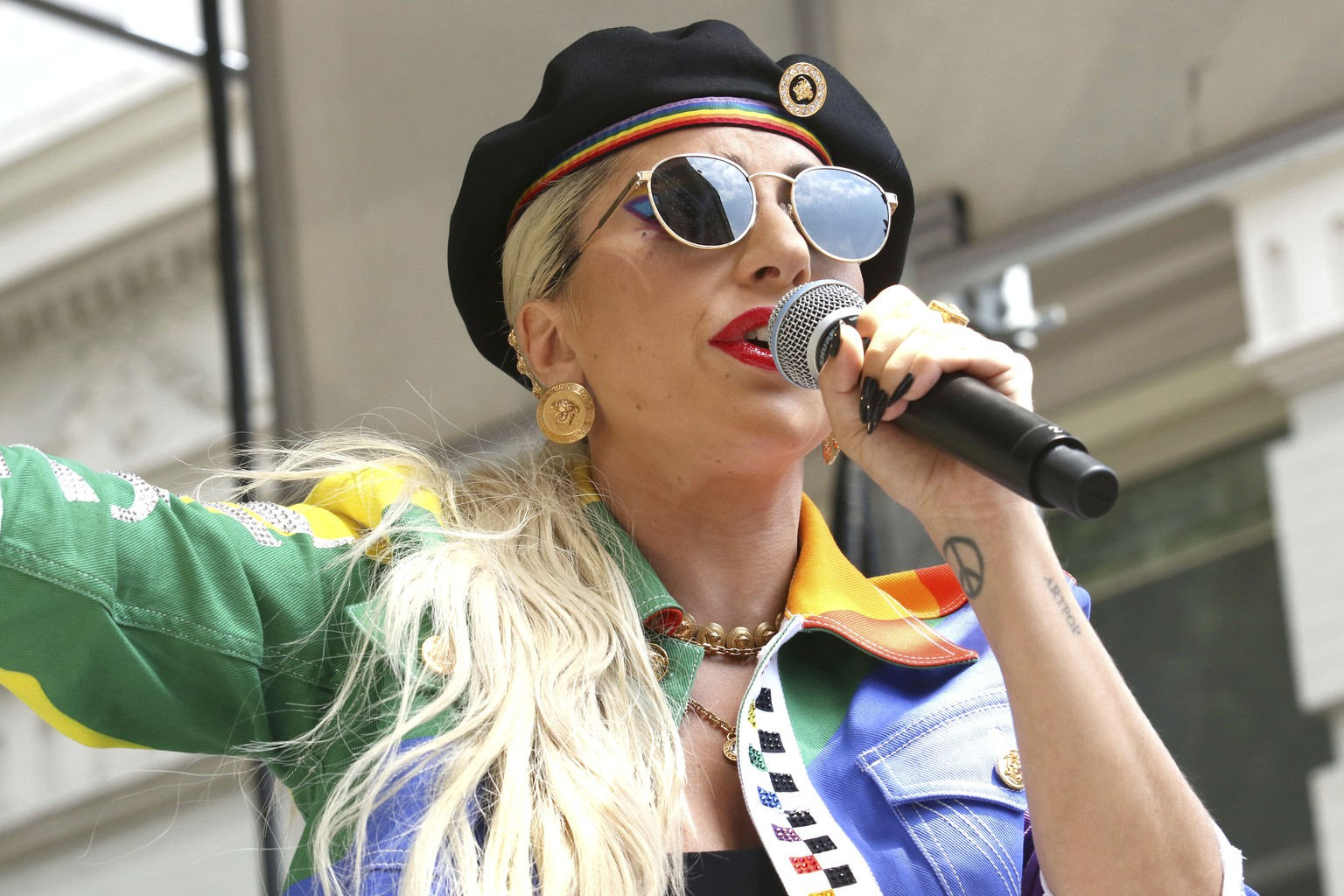 FILE - This June 28, 2019 file photo shows Lady Gaga performing in the second annual Stonewall Day honoring the 50th anniversary of the Stonewall riots, hosted by Pride Live and iHeartMedia in New York. Officials say Lady Gaga's dog walker was shot and her two French bulldogs stolen in Hollywood during an armed robbery. Los Angeles police are seeking two suspects, thought it's not known if both were armed, in connection with the Wednesday night shooting. (Photo by Greg Allen/Invision/AP, File) Lady Gaga
