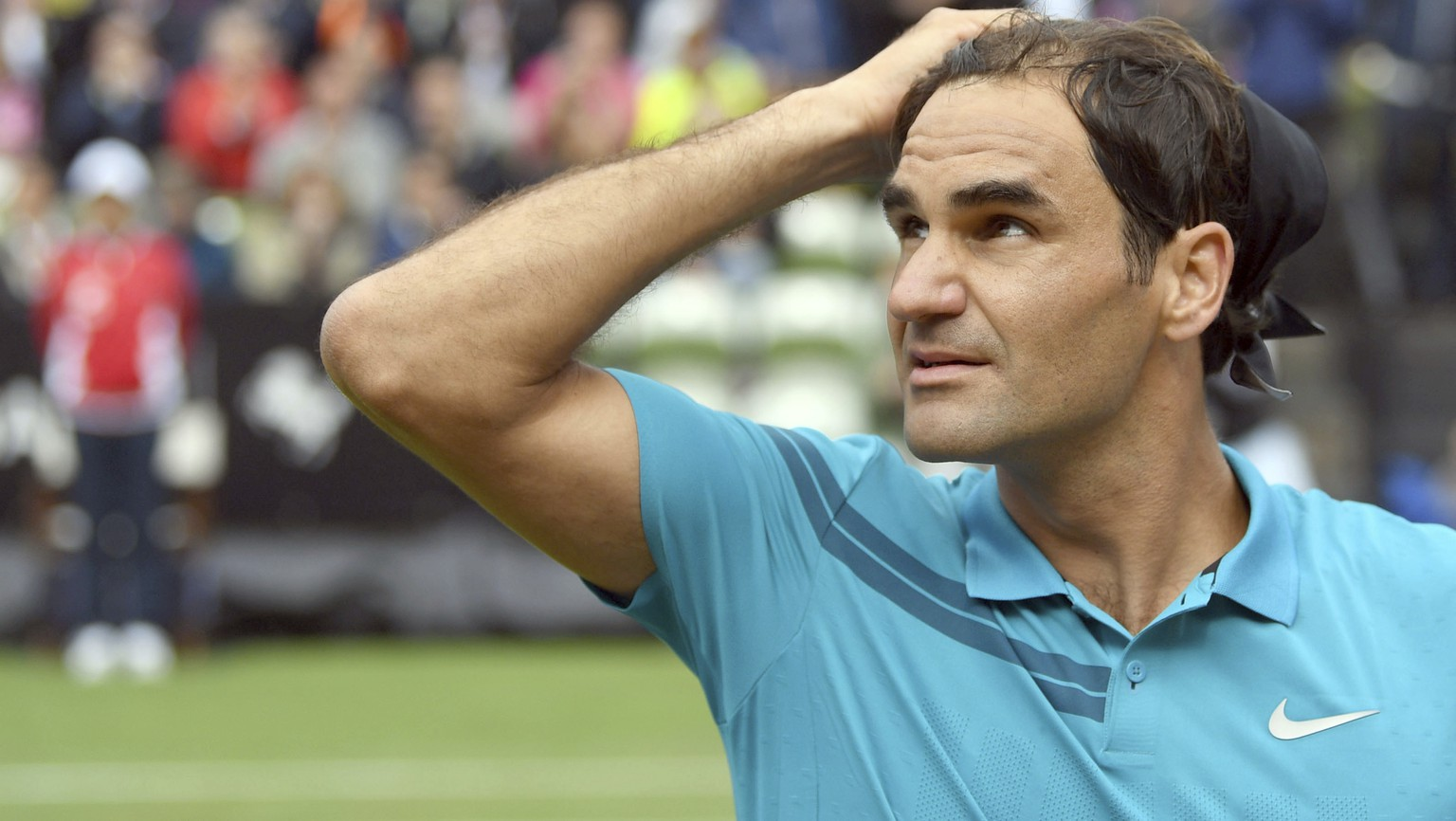 Roger Federer reacts as he defeats Mischa Zverev during the ATP Mercedes Cup tournament in Stuttgart, Germany, Wednesday, June 13, 2018. (Marijan Murat/dpa via AP)