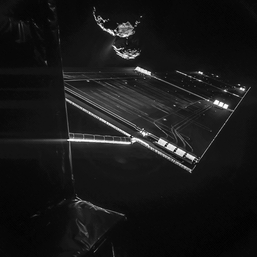 epa04487462 A handout picture made available by the European Space Agency (ESA) on 13 November 2014 and made by the CIVA camera on Rosetta's Philae lander, shows as the spacecraft have snapped a selfie with comet 67P/Churyumov–Gerasimenko from a distance of about 16 km from the surface of the comet. The image was taken on 07 October 2014 and captures the side of the Rosetta spacecraft and one of Rosetta's 14 m-long solar wings, with the comet in the background. Two images with different exposure times were combined to bring out the faint details in this very high contrast situation. The comet's active 'neck' region is clearly visible, with streams of dust and gas extending away from the surface. ESA wrote a new chapter in the history of space exploration on 12 November 2014 by landing the probe Philae on the surface of a comet for the first time, marking the climax of a decade-long mission. But the mission encountered a problem after the lander failed to deploy anchors to keep the craft tethered to the comet.  EPA/ESA/Rosetta/Philae/CIVA Black and white only HANDOUT EDITORIAL USE ONLY/NO SALES