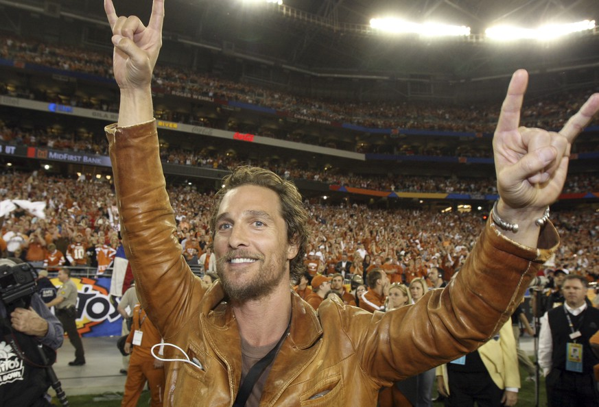 FILE - In this  Jan. 5, 2009, file photo, actor Matthew McConaughey celebrates after Texas defeated Ohio State 24-21 in the Fiesta Bowl NCAA college football game in Glendale, Ariz. The University of Texas announced June 30, 2016, that McConaughey is teaching a filmmaking course at the school. (AP Photo/Ross D. Franklin, File)