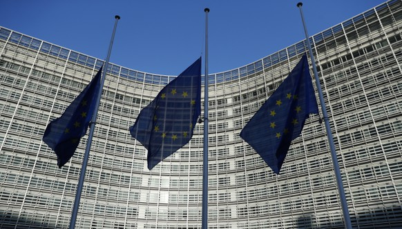 EU flags fly at half staff outside the headquarters of the EU in Brussels, Belgium, Wednesday, Dec., 12, 2018, in respect for the victims of the shooting attack at a Christmas market in Strasbourg, France, that happened Tuesday.  An EU Summit will be held in Brussels starting Thursday. (AP Photo/Alastair Grant)