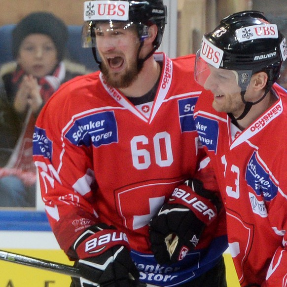 Team Suisse player Tristan Scherwey and Simon Bodenmann celebrates after scoring 1:0 during the game between Team Suisse and Haemeenlinna PK at the 91th Spengler Cup ice hockey tournament in Davos, Switzerland, Thursday, December 28, 2017. (KEYSTONE/Melanie Duchene)