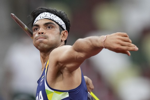 Neeraj Chopra, of India, competes in the men's javelin throw final at the 2020 Summer Olympics, Saturday, Aug. 7, 2021, in Tokyo. (AP Photo/Matthias Schrader)