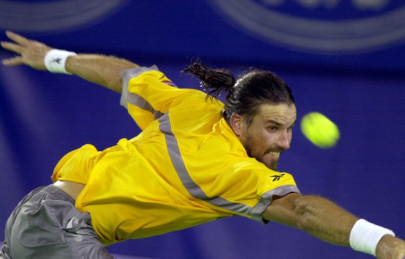 Australia's Pat Rafter at full stretch in his semi- final match against USA's Andre Agassi at the Australian Open Tennis Championships in Melbourne, Thursday, Jan. 25 , 2001. (AP Photo/Steve Holland)