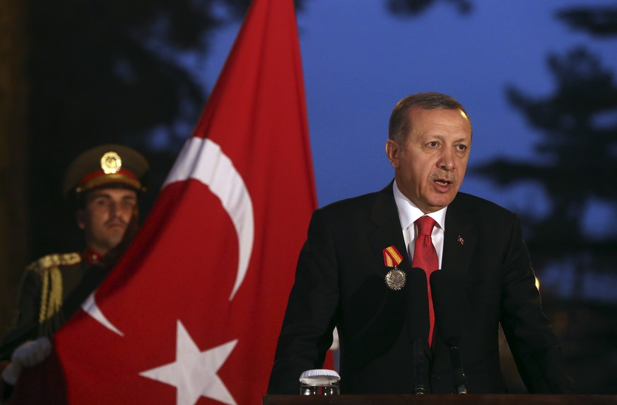 Turkish President Recep Tayyip Erdogan speaks during a news conference with Afghanistan's President Ashraf Ghani Ahmadzai, at the presidential palace in Kabul, Afghanistan, Saturday, Oct. 18, 2014.  (AP Photo/Massoud Hossaini)