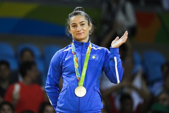 Kosovo's Majlinda Kelmendi receives the gold medal after winning the women's 52-kg judo competition at the 2016 Summer Olympics in Rio de Janeiro, Brazil, Sunday, Aug. 7, 2016. (AP Photo/Markus Schreiber)