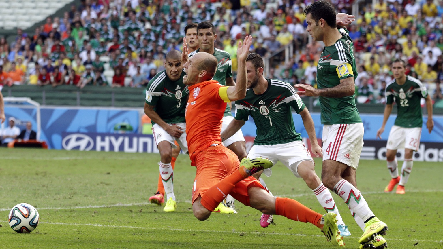 AP10ThingsToSee - Netherlands' Arjen Robben, center, goes down to win a penalty during the World Cup round of 16 soccer match between the Netherlands and Mexico at the Arena Castelao in Fortaleza, Brazil, Sunday, June 29, 2014. Netherlands won the match 2-1. (AP Photo/Wong Maye-E)