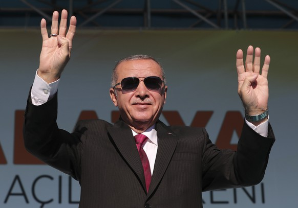 Turkey's President Recep Tayyip Erdogan salutes supporters during a rally in Malatya, Turkey, Sunday, Sept. 8, 2019. Turkish and U.S. troops conducted their first joint ground patrol in northeastern Syria on Sunday as part of a so-called