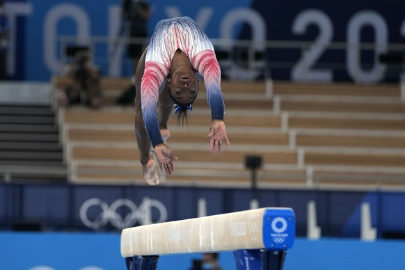 Simone Biles, of the United States, performs on the balance beam during the artistic gymnastics women's apparatus final at the 2020 Summer Olympics, Tuesday, Aug. 3, 2021, in Tokyo, Japan. (AP Photo/Natacha Pisarenko)