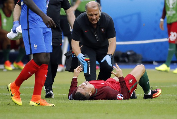 epa05419078 Cristiano Ronaldo of Portugal reacts on the pitch after a tackle during the UEFA EURO 2016 Final match between Portugal and France at Stade de France in Saint-Denis, France, 10 July 2016. Spain won the last EURO 2012.   (RESTRICTIONS APPLY: For editorial news reporting purposes only. Not used for commercial or marketing purposes without prior written approval of UEFA. Images must appear as still images and must not emulate match action video footage. Photographs published in online publications (whether via the Internet or otherwise) shall have an interval of at least 20 seconds between the posting.)  EPA/ETIENNE LAURENT   EDITORIAL USE ONLY