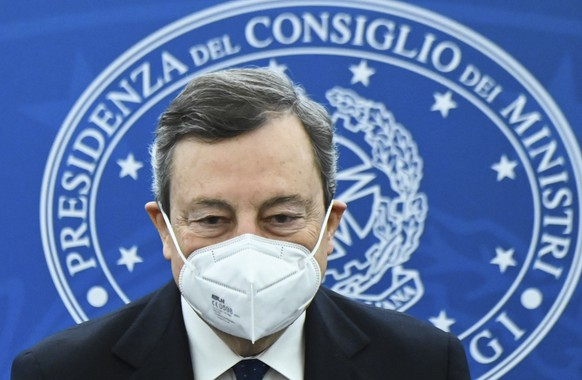Italy's Prime Minister, Mario Draghi arrives for a joint press conference with Italy's Economy Minister and Italy's Minister for Labour and Social Policy following a Cabinet meeting in Rome, Friday, March 19, 2021. (Alberto Pizzoli/Pool photo via AP)
