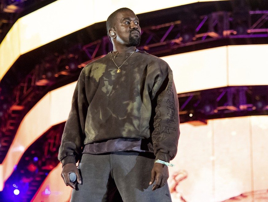 "FILE - This April 20, 2019 file photo shows Kanye West performing at the Coachella Music & Arts Festival in Indio, Calif. West has unveiled his ""Jesus Is King"" IMAX film featuring a gospel choir performing at artist James Turrell's dramatic Roden Crater in the Arizona desert. West showed the 35-minute film off to fans at an event Wednesday night at The Forum in Inglewood, Calif. (Photo by Amy Harris/Invision/AP, File) Kanye West"