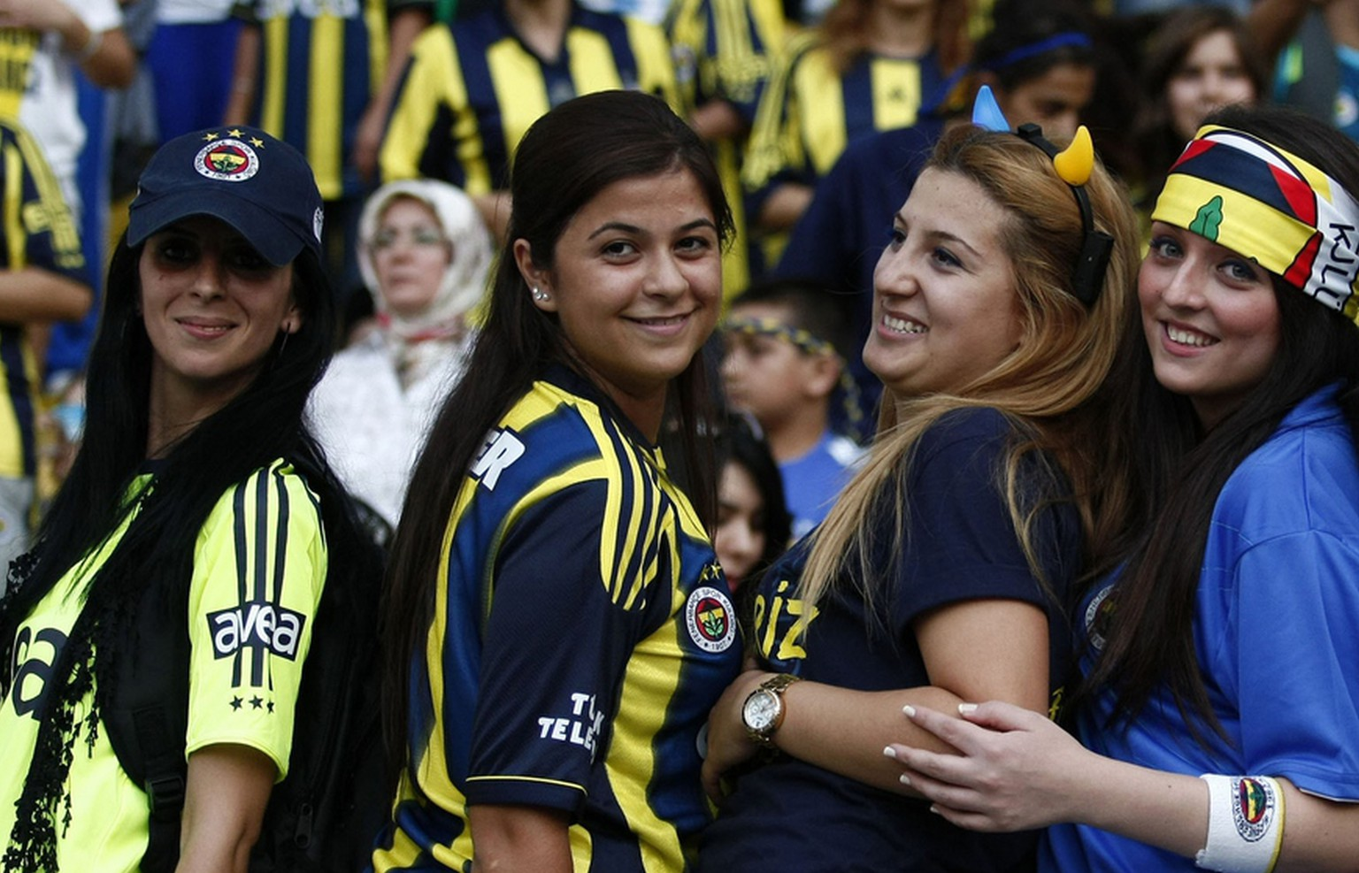 More than 41,000 women and children filled Sukru Saracoglu Stadium to watch Fenerbahce play against Manisapor in Turkish League soccer match in Istanbul, Turkey, Tuesday, Sept. 20. 2011. Turkey came up with a radical solution for tackling crowd violence at football matches _ ban the men and let only women and children in. Under new rules approved by Turkey's football association, only women and children under the age of 12 will be admitted to watch games _ for free _ involving teams which have been sanctioned for unruly behavior by their fans. Fenerbahce was ordered to play two home matches without any spectators after its fans invaded the pitch during a friendly against Ukrainian champion Shakhtar Donetsk.(AP Photo)
