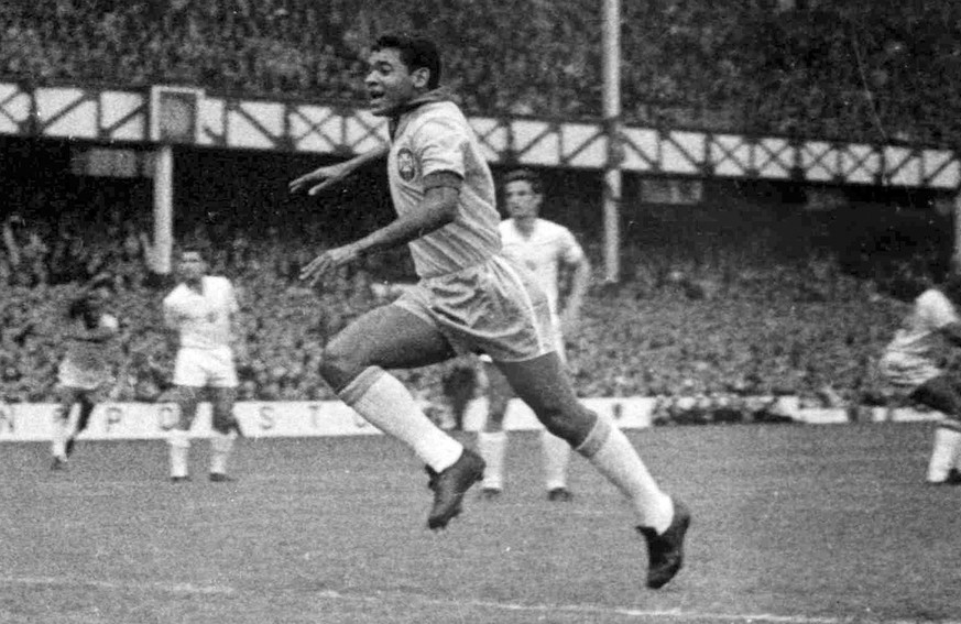 ** ADVANCE FOR WEEKEND EDITONS, MAY 29-30 **  FILE- In this July 12, 1966, file photo, Brazil forward Garrincha runs towards the Bulgaria goal after scoring the second goal for his country in a World Cup soccer match at Goodison Park in Liverpool, England. (AP Photo/Bippa, File)