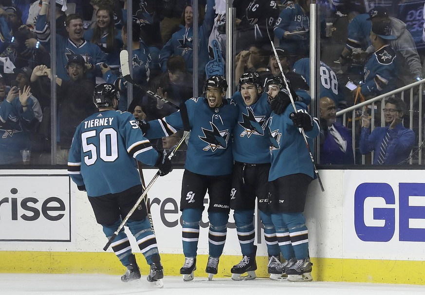San Jose Sharks right wing Timo Meier, from Switzerland, center right, celebrates with teammates after scoring a goal against the Vegas Golden Knights during the second period of Game 3 of an NHL hockey second-round playoff series in San Jose, Calif., Monday, April 30, 2018. (AP Photo/Jeff Chiu)